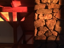 Sun on stone and timber. View from inside the office.